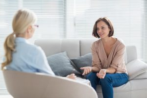Image of 2 women in an office participating in counseling for women. One is the therapist and one is the woman getting counseling.