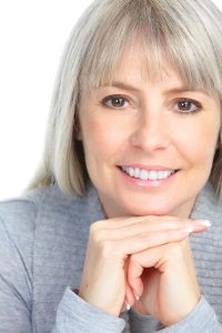 Image of a happy smiling woman.