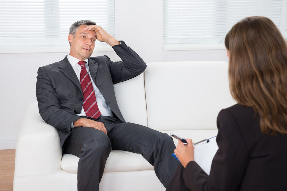 Image of man on couch participating in counseling for men